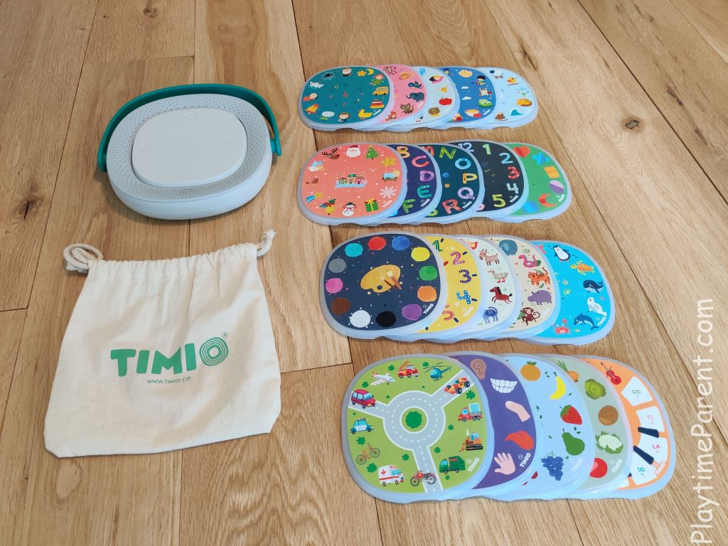 TIMIO Review of full box content including discs, player, and carry pouch