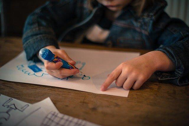 Preschooler drawing on paper